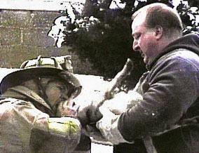 Firemen resuscitating Pixie