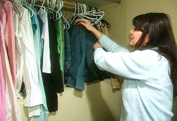 Marnie inspects her daughter's closet.