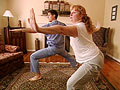 Dr. Oz and woman do yoga