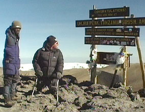 Warren at the summit of Mount Kilimanjaro