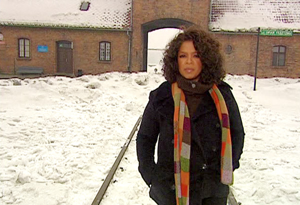 Oprah at the entrance to Auschwitz