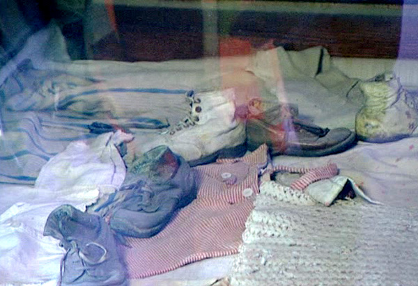A display case full of Auschwitz prisoners' baby clothes