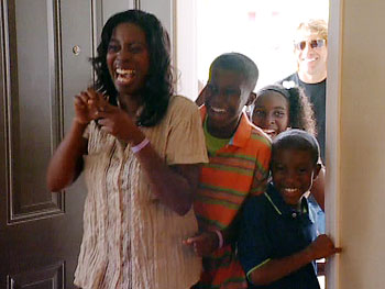 Danielle and her kids see their new home.