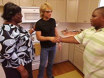 Jon Bon Jovi shows Sylvia and Chester around their new home.