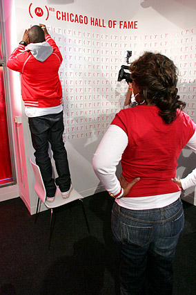 Kanye West signs the Wall of Fame.