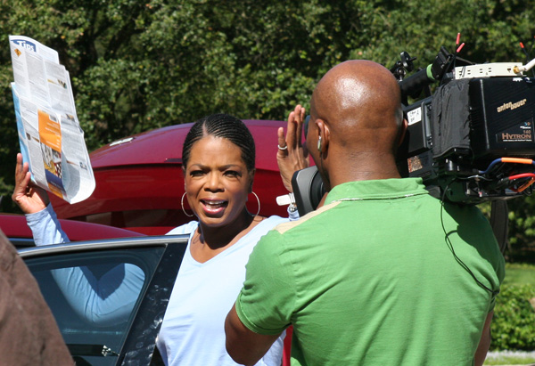 Oprah and cameraman at her home