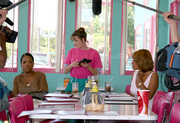 Oprah orders lunch while the crew observes.