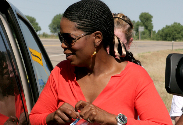 Oprah holding some car snacks