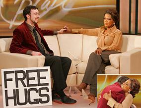 Juan Mann hugs Oprah.