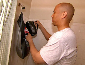 Mayor Booker fills his shower with warm water.