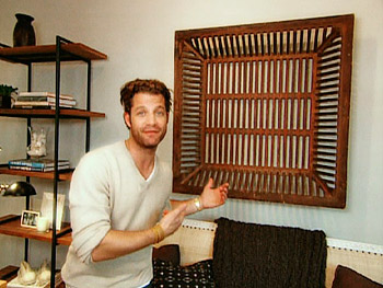 Nate Berkus hangs an antique sifter instead of framed art on a wall.