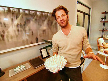 Nate Berkus holds a piece of coral.