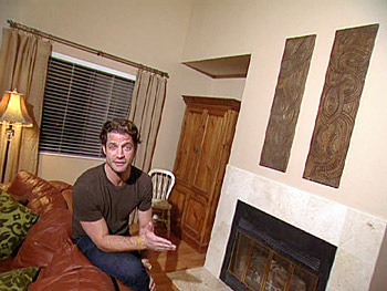 Nate shows off the new fireplace look.