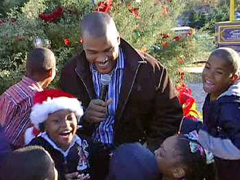 Tyler Perry delivers Christmas gifts to Oprah Katrina Homes families.