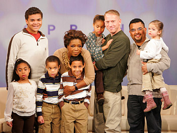 Oprah meets Mark, Andy and their six adopted children.