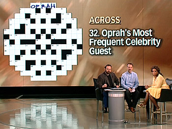 Merl Reagle, Will Shortz and Oprah fill out an 'Oprah' crossword puzzle.