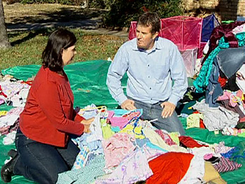 Peter and Janet sort through clothes.
