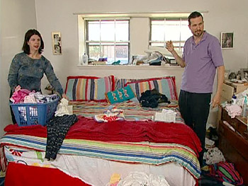 Janet and Charlton sort through their bedroom clutter.