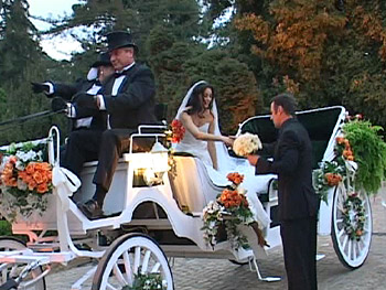Colin helps Urania out of her horse-drawn carriage.
