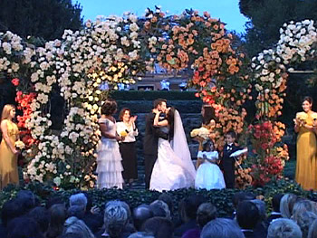 Bob and Urania say 'I do' under the roses.