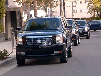 The guests arrive in stylish Cadillac Escalades.