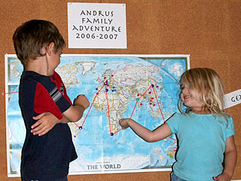 Kieran and Asher look at the plan for their world trip.