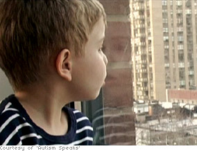 An autistic child stares out of a window.