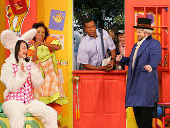The cast of 'Thank God You're Here' performs a skit.