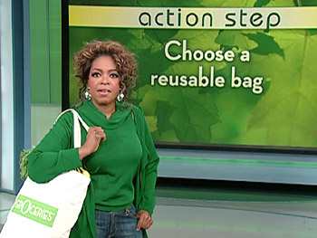 Oprah models her new organic canvas bag.