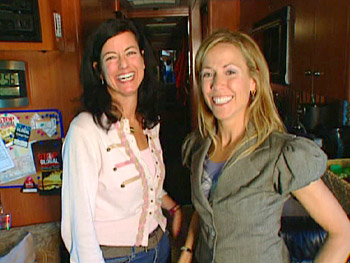 Singer Sheryl Crow and activist Laurie David on their tour bus.