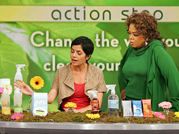 Simran shows Oprah organic cleaning options.