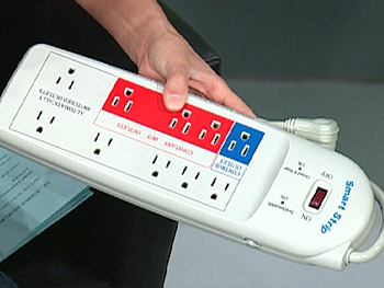 Simran shows Oprah the Smart Power Strip.