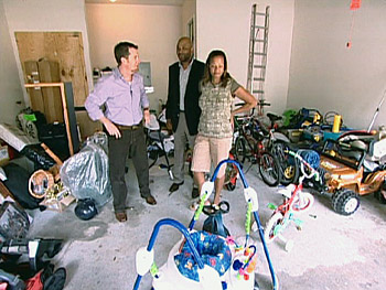 Darius, Peter and Kristen survey the cluttered garage
