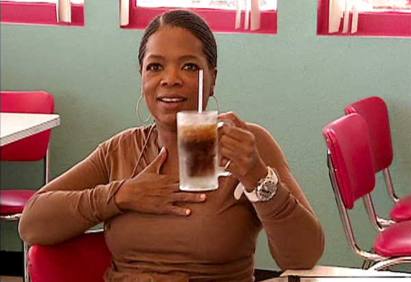 Oprah drinking root beer at Mr. D'z Route 66 Diner