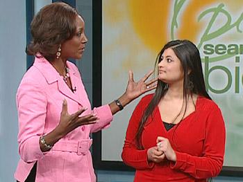 QVC host Jayne Brown explains what Aneela has won.