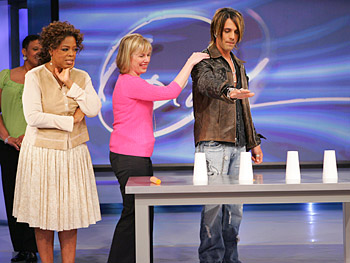 Criss Angel tries to determine which cup hides a sharp knife.