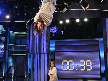 Criss Angel dangles above the audience as he tries to break Houdini's record.