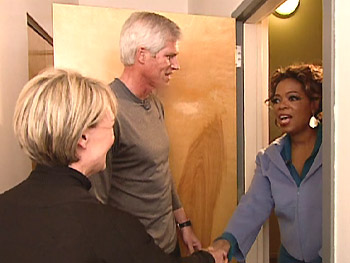 Oprah surprises her neighbors, Adrianne and Scott.