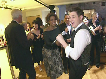 Michael Bublé dances with Oprah.