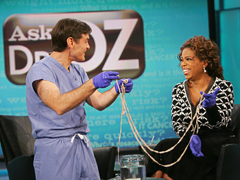 Dr. Oz and Oprah hold a tapeworm.