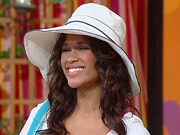 Itika models Oprah's favorite summer hat.