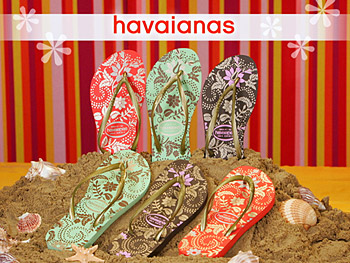 A staff member models Havaianas flip-flops.