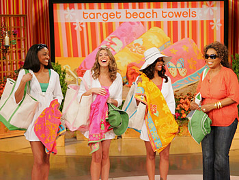 Oprah's staffers show off their Target beach towels.