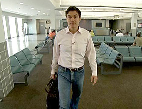 Dr. Oz returns to the airport that once housed a makeshift morgue.