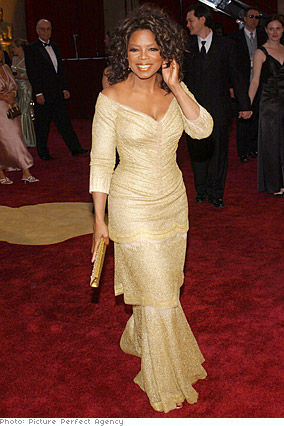 Oprah in gold dress by Vera Wang