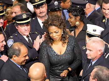 Oprah greets New York emergency workers.