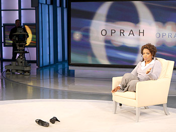 Oprah talks with the audience.