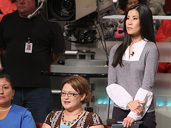 'Oprah Show' correspondent Lisa Ling prepares to interview audience members.