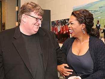 Oprah shares a laugh with 'Sicko' director Michael Moore in the hallway outside the studio.