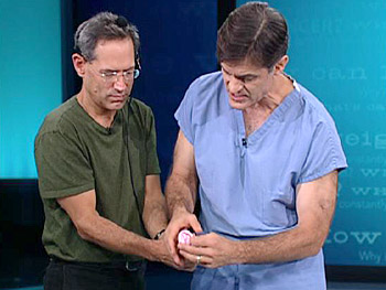 Dr. Oz demonstrates how to wash an uncircumcised penis.